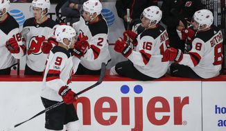 New Jersey Devils left wing Taylor Hall (9) celebrates with teammates after scoring against the Chicago Blackhawks during the second period of an NHL hockey game Sunday, Nov. 12, 2017, in Chicago. (AP Photo/Kamil Krzaczynski)