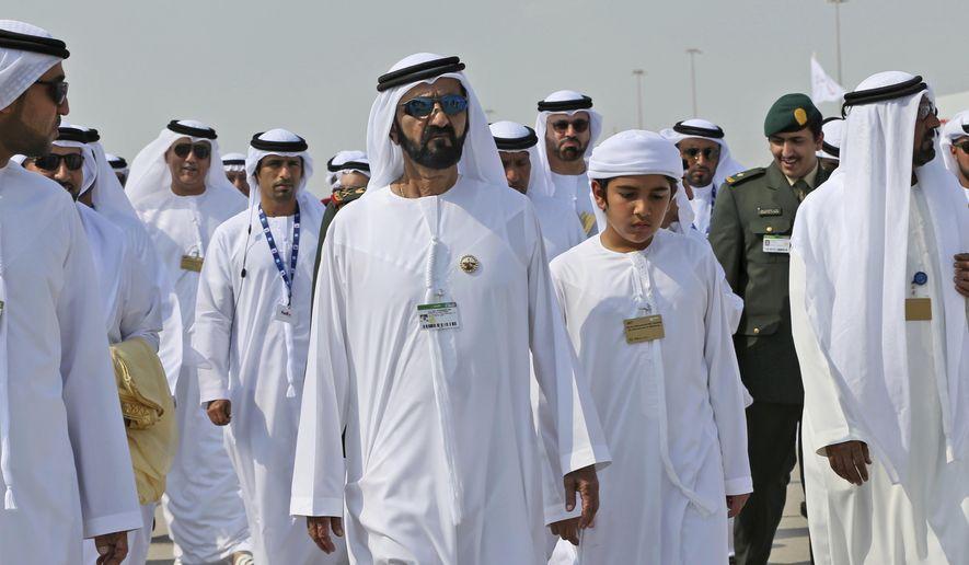 Sheikh Mohammed bin Rashid Al Maktoum, vice president and prime minister of the UAE and ruler of Dubai visits the Dubai Air Show, United Arab Emirates, Sunday, Nov. 12, 2017. (AP Photo/Kamran Jebreili) ** FILE **