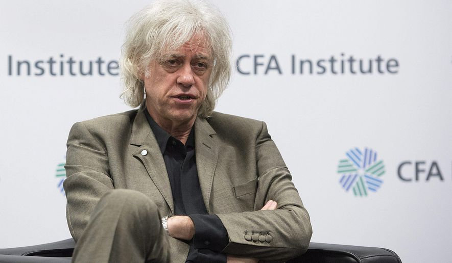 "FILE- In this May 11, 2016, file photo, musician-activist Bob Geldof speaks to reporters following his speech at the CFA Institute annual conference in Montreal. Geldof says he is returning his Freedom of the City of Dublin honor because it is also held by Myanmar leader Aung San Suu Kyi, accusing her of complicity for what he and others, including the United Nations, call ""ethnic cleansing"" of Rohingya Muslims in the Asian nation. (Graham Hughes/The Canadian Press via AP, File)"