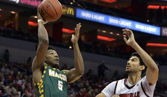 George Mason guard Jaire Grayer (5) shoots over the defense of Louisville forward Anas Mahmoud (14) during the first half of an NCAA college basketball game, Sunday, Nov. 12, 2017, in Louisville, Ky. (AP Photo/Timothy D. Easley)