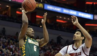 George Mason guard Jaire Grayer (5) shoots over the defense of Louisville forward Anas Mahmoud (14) during the first half of an NCAA college basketball game, Sunday, Nov. 12, 2017, in Louisville, Ky. (AP Photo/Timothy D. Easley) **FILE**