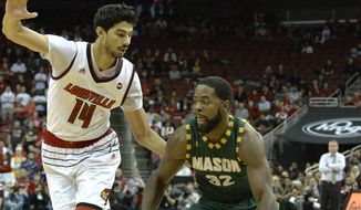 George Mason guard Ian Boyd (32) attempts to drive past the defense of Louisville forward Anas Mahmoud (14) during the first half of an NCAA college basketball game, Sunday, Nov. 12, 2017, in Louisville, Ky. (AP Photo/Timothy D. Easley) **FILE**