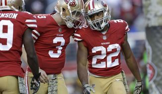 San Francisco 49ers running back Matt Breida (22) is congratulated by quarterback C.J. Beathard (3) after scoring a touchdown against the New York Giants during the second half of an NFL football game in Santa Clara, Calif., Sunday, Nov. 12, 2017. (AP Photo/Marcio Jose Sanchez)