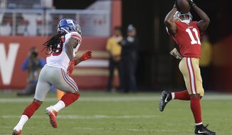 San Francisco 49ers wide receiver Marquise Goodwin (11) catches a touchdown pass in front of New York Giants cornerback Janoris Jenkins, left, during the first half of an NFL football game in Santa Clara, Calif., Sunday, Nov. 12, 2017. (AP Photo/Ben Margot)