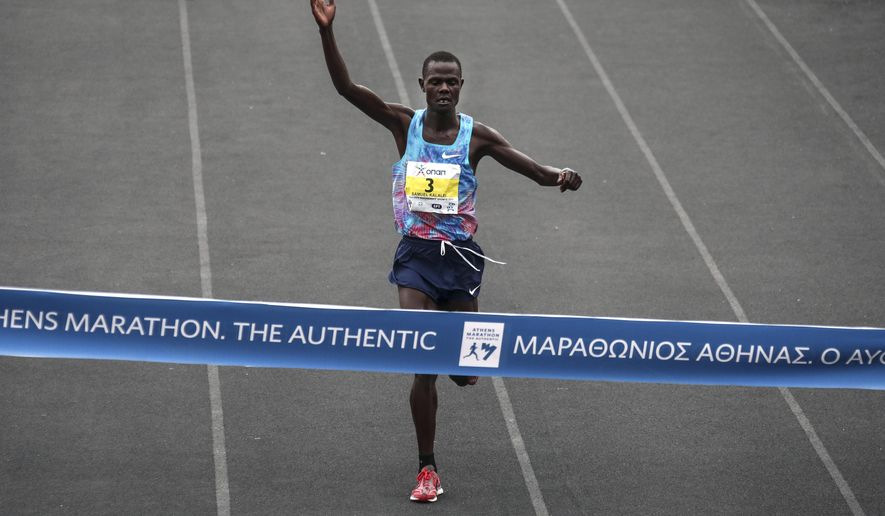 Kenya's Samuel Kalalei finishes in the first place at the 35th Athens Marathon at Panathenaikon stadium in Athens, Sunday, Nov. 12, 2017. Kalalei has won the Athens Marathon, beating compatriot Milton Rotich by just over two minutes. (AP Photo/Yorgos Karahalis)