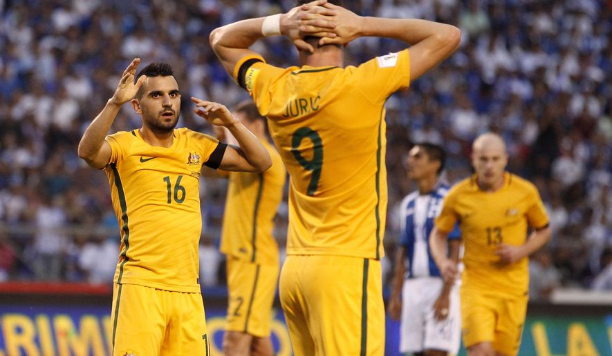 Australia's player stand on the pitch after a 0-0 draw during the first leg of a World Cup qualifier play-off against Honduras, at the Olympic Stadium in San Pedro Sula, Honduras, Friday, Nov. 10, 2017. (AP Photo/Moises Castillo)