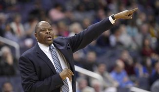Georgetown head coach Patrick Ewing points during the first half of an NCAA college basketball game against Jacksonville, Sunday, Nov. 12, 2017, in Washington. (AP Photo/Nick Wass) **FILE**