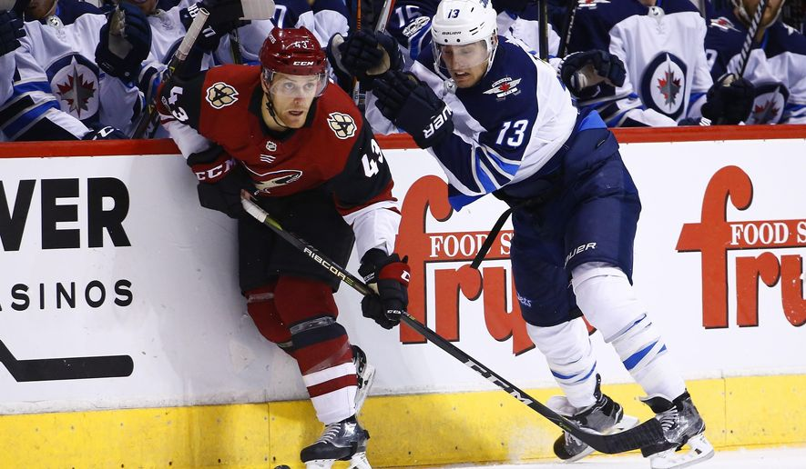 Arizona Coyotes defenseman Dakota Mermis (43) skates with the puck against Winnipeg Jets left wing Brandon Tanev (13) during the first period of an NHL hockey game Saturday, Nov. 11, 2017, in Glendale, Ariz. (AP Photo/Ross D. Franklin)