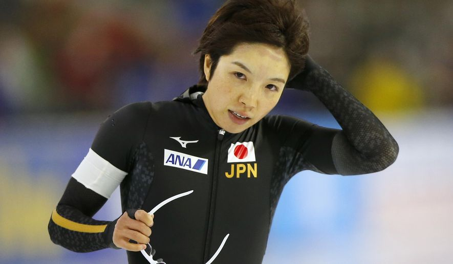 Japan's Nao Kodaira removes the hood of her race suit after the women's 1000 meter race of the Speedskating World Cup at the Thialf ice rink in Heerenveen, Netherlands, Sunday, Nov. 12, 2017. (AP Photo/Peter Dejong)