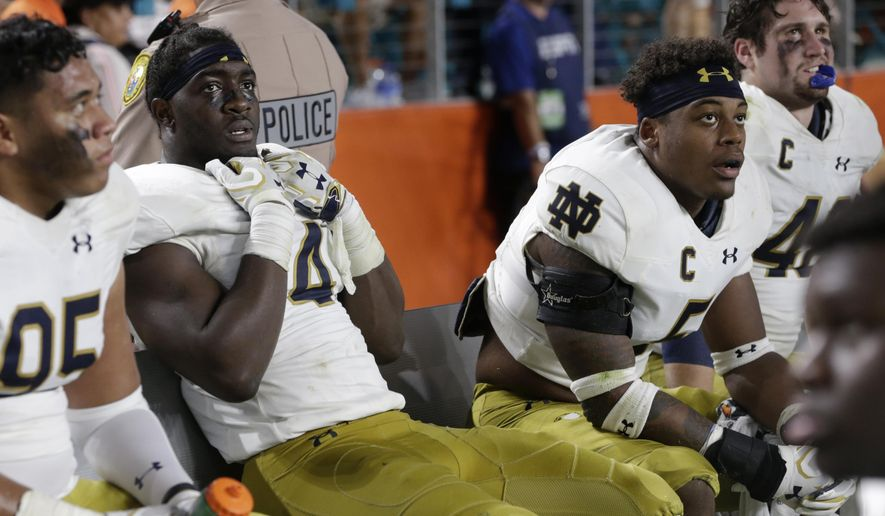 Notre Dame linebacker Te'von Coney (4) watches from the bench during the second half of an NCAA college football game against Miami, Saturday, Nov. 11, 2017, in Miami Gardens, Fla. Miami won 41-8. (AP Photo/Lynne Sladky)