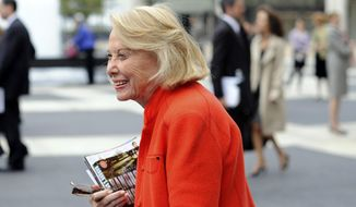 In this Aug. 9, 2009, file photo, Liz Smith leaves the Celebration of Life Memorial ceremony for Walter Cronkite at Avery Fisher Hall in New York. Smith, a gossip columnist whose mixture of banter, barbs, and bon mots about the glitterati helped her climb the A-list as high as many of the celebrities she covered, has died. Literary agent Joni Evans told The Associated Press she died in New York on Sunday, Nov. 12, 2017. She was 94. (AP Photo/Stephen Chernin, File)