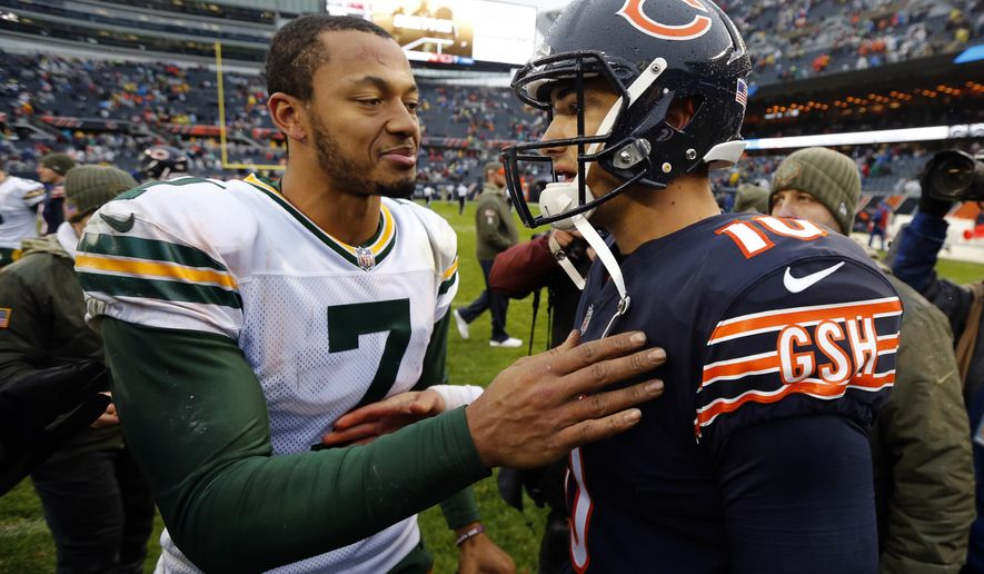 Green Bay Packers quarterback Brett Hundley (7) greets Chicago Bears quarterback Mitchell Trubisky (10) after an NFL football game, Sunday, Nov. 12, 2017, in Chicago. The Packers won 23-16. (AP Photo/Charles Rex Arbogast)