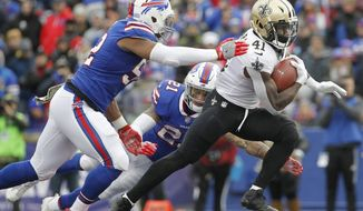 New Orleans Saints running back Alvin Kamara (41) rushes past Buffalo Bills' Preston Brown (52) and Jordan Poyer (21) during the second half of an NFL football game Sunday, Nov. 12, 2017, in Orchard Park, N.Y. (AP Photo/Jeffrey T. Barnes)
