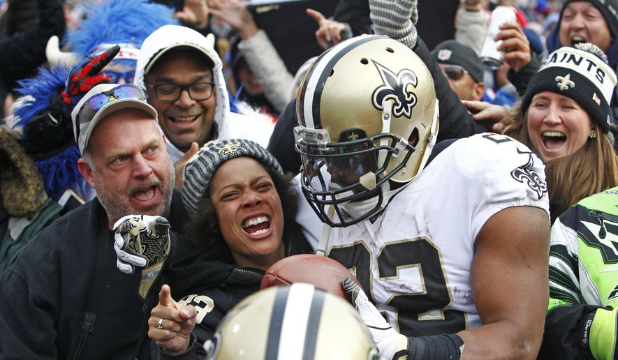 New Orleans Saints running back Mark Ingram (22) celebrates with fans and teammates after scoring a touchdown during the first half of an NFL football game against the Buffalo Bills Sunday, Nov. 12, 2017, in Orchard Park, N.Y. Ingram scored three touchdowns as the Saints won 47-10. (AP Photo/Jeffrey T. Barnes)