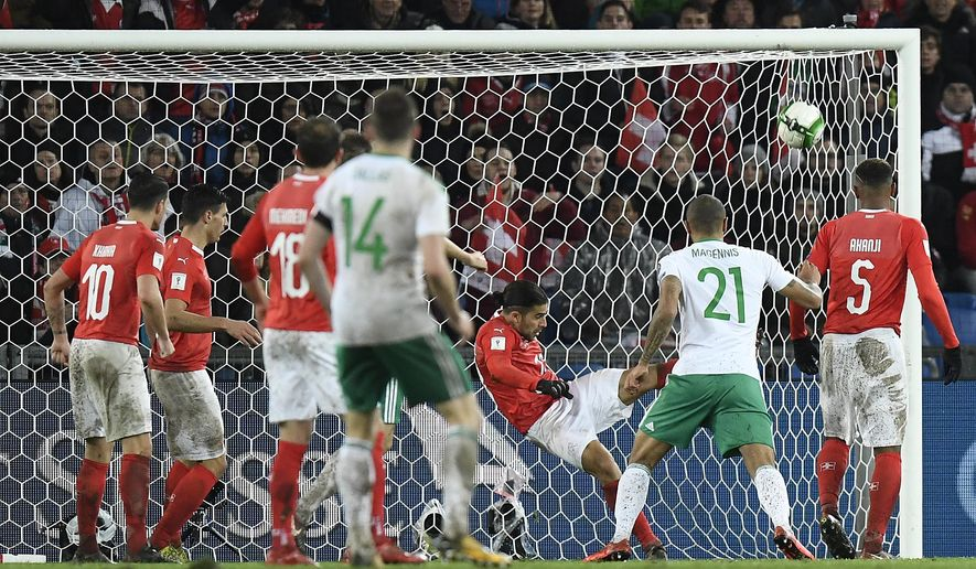 Switzerland's defender Ricardo Rodriguez, center right, saves a ball on the line goal  during the World Cup play-offs second leg soccer match between Switzerland and Northern Ireland at the St. Jakob-Park stadium in Basel, Switzerland, Sunday, Nov. 12, 2017. (Jean-Christophe Bott/Keystone via AP)