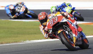 Moto GP World Champion, Spain's rider Marc Marquez of the Repsol Honda Team steers his motorcycle at the MotoGP race during the Valencia Motorcycle Grand Prix, the last race of the season, at the Ricardo Tormo circuit in Cheste near Valencia, Spain, Sunday, Nov. 12, 2017. (AP Photo/Alberto Saiz)