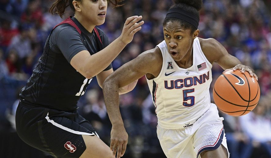 Connecticut's Crystal Dangerfield drives on Stanford's Marta Sniezek during the first quarter of an NCAA college basketball game, Sunday, Nov. 12, 2017, in Columbus, Ohio. (AP Photo/David Dermer)