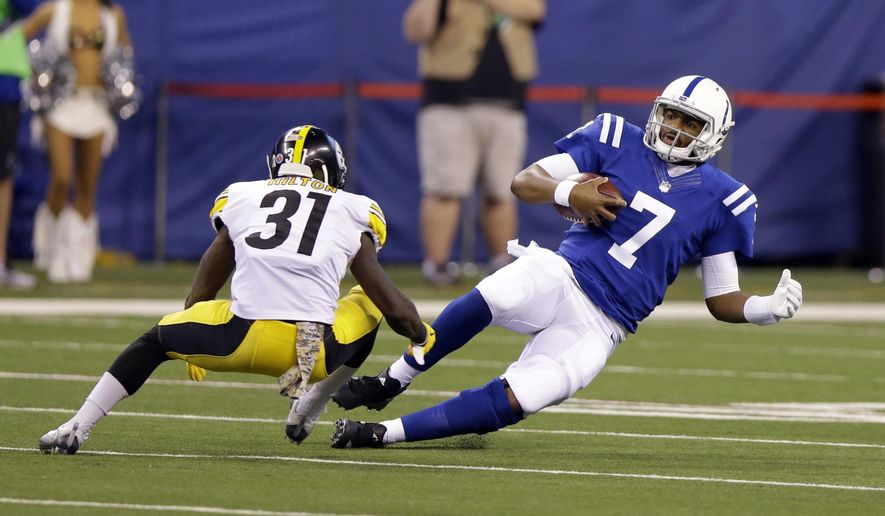 Indianapolis Colts quarterback Jacoby Brissett (7) slides to a first down in front of Pittsburgh Steelers defensive back Mike Hilton (31) during the first half of an NFL football game in Indianapolis, Sunday, Nov. 12, 2017. (AP Photo/Michael Conroy)