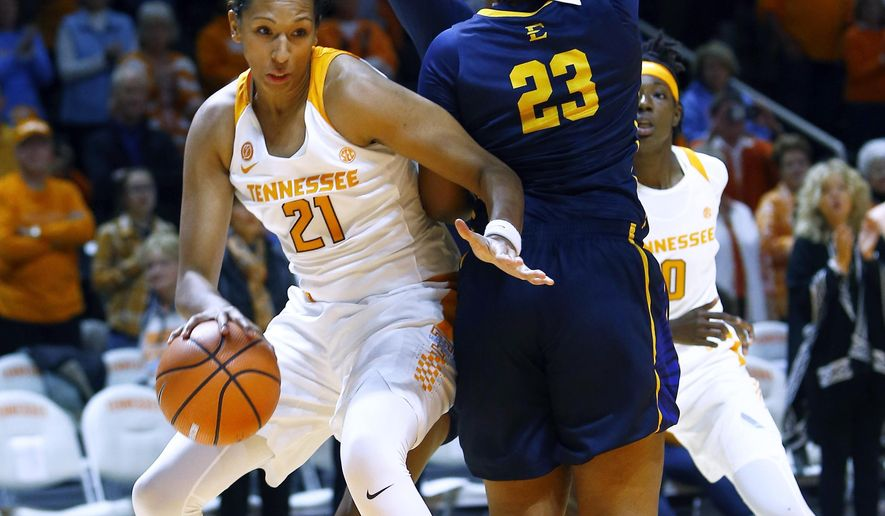 Tennessee center Mercedes Russell (21) drives past East Tennessee State forward Britney Snowden (23) during their NCAA basketball game, Sunday, Nov. 12, 2017, in Knoxville, Tenn. (Wade Payne/Knoxville News Sentinel via AP)