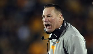 Tennessee head coach Butch Jones yells from the sideline during the first half of an NCAA college football game against Missouri, Saturday, Nov. 11, 2017, in Columbia, Mo. (AP Photo/Jeff Roberson)