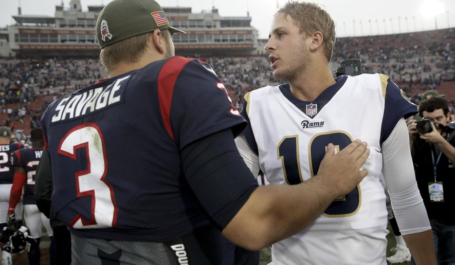 Los Angeles Rams quarterback Jared Goff, right, greets Houston Texans quarterback Tom Savage after an NFL football game Sunday, Nov. 12, 2017, in Los Angeles. (AP Photo/Jae C. Hong)