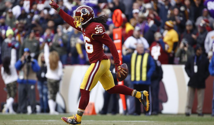 Washington Redskins free safety D.J. Swearinger (36) celebrates his interception of a pass intended for Minnesota Vikings tight end Kyle Rudolph during the second half of an NFL football game against the Minnesota Vikings in Landover, Md., Sunday, Nov. 12, 2017. (AP Photo/Patrick Semansky)