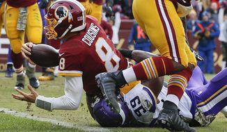 Washington Redskins quarterback Kirk Cousins (8) scores on a quarterback keeper during the second half of an NFL football game against the Minnesota Vikings in Landover, Md., Sunday, Nov. 12, 2017. (AP Photo/Alex Brandon)