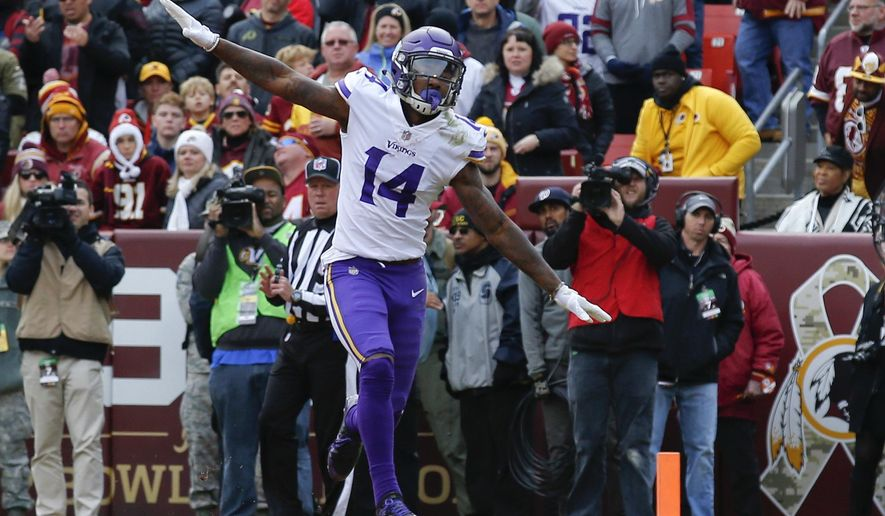 Minnesota Vikings wide receiver Stefon Diggs (14) celebrates his touchdown during the first half of an NFL football game against the Washington Redskins in Landover, Md., Sunday, Nov. 12, 2017. (AP Photo/Alex Brandon)