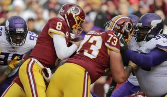 Washington Redskins quarterback Kirk Cousins (8) dives through the line on a keeper for a touchdown during the first half of an NFL football game against the Minnesota Vikings in Landover, Md., Sunday, Nov. 12, 2017. (AP Photo/Mark Tenally) ** FILE **