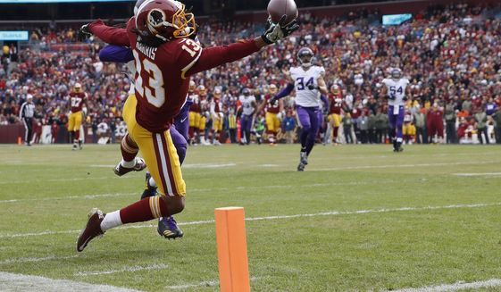 Washington Redskins wide receiver Maurice Harris (13) pulls in a touchdown pass during the first half of an NFL football game against the Minnesota Vikings in Landover, Md., Sunday, Nov. 12, 2017. (AP Photo/Alex Brandon)