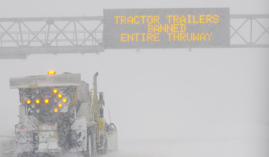 A snowplow clears a Eastbound section of the I-90 Thruway near Albany, after New York Gov. Andrew Cuomo issued a travel ban on the thruway for tractor trailers due to heavy blowing snow N.Y.,Tuesday, March 14, 2017. (AP Photo/Hans Pennink)