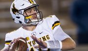 Wyoming quarterback Josh Allen (17) warms up as they face off against Air Force in an NCAA college football game in Colorado Springs, Colo., Saturday Nov. 11, 2017. (Dougal Brownlie/The Gazette via AP) ** FILE **