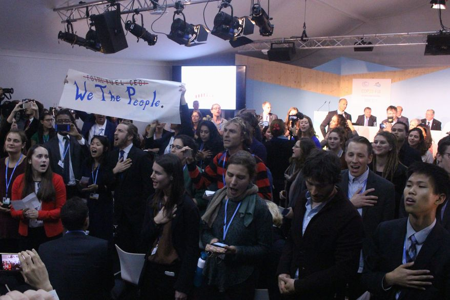 U.S. officials have pressed the case for coal despite protesters at the COP23 climate change conference in Bonn, Germany, decrying President Trump's climate policies. (Geoff Hill/Special to the Washington Times)