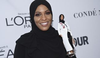Ibtihaj Muhammad holds a Barbie doll in her likeness at the 2017 Glamour Women of the Year Awards at Kings Theatre on Monday, Nov. 13, 2017, in New York. (Photo by Evan Agostini/Invision/AP)