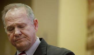 Former Alabama Chief Justice and U.S. Senate candidate Roy Moore speaks at the Vestavia Hills Public library, Saturday, Nov. 11, 2017, in Birmingham, Ala. According to a Washington Post story Nov. 9, an Alabama woman said Moore made inappropriate advances and had sexual contact with her when she was 14. (AP Photo/Brynn Anderson)