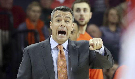 Virginia coach Tony Bennett reacts to a play during the team's NCAA college basketball game against Austin Peay on Monday, Nov. 13, 2017, in Charlottesville, Va. (Andrew Shurtleff/The Daily Progress via AP) **FILE**