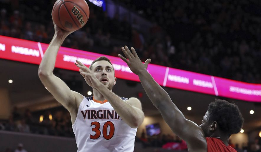 Virginia forward Jay Huff (30) shoots over Austin Peay guard Terry Taylor (21) during an NCAA college basketball game Monday, Nov. 13, 2017, in Charlottesville, Va. (Andrew Shurtleff/The Daily Progress via AP)