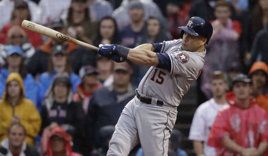 FILE - In this Oct. 9, 2017, file photo, Houston Astros designated hitter Carlos Beltran takes a swing during the ninth inning of Game 4 of baseball's American League Division Series, in Boston. Beltran is retiring after winning his first World Series title in his 20th major league season. The 40-year-old made the announcement Monday, Nov. 13, 2017, 12 days after the Houston Astros beat the Los Angeles Dodgers in Game 7 of the World Series. (AP Photo/Charles Krupa, File) **FILE**