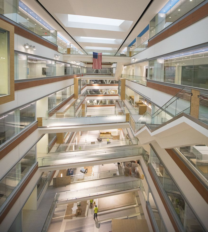 This photo, provided by University of Buffalo, shows ongoing construction for the new Jacobs School of Medicine and Biomedical Sciences on University of Buffalo's downtown medical campus, Wednesday Oct. 25, 2017, in Buffalo, N.Y.  From the glass-walled offices and conference rooms stacked around a central atrium, lounge furniture grouped in sunny spaces and lecture hall desks that morph into conference tables, the design reflects the idea that medical school is ever more a group endeavor, say university officials, who are beginning to move in before the start of classes in January.  (Douglas Levere/University of Buffalo via AP)