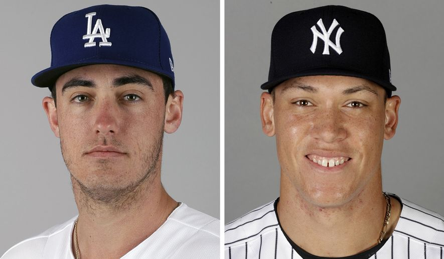 FILE - These are 2017 file photos showing Los Angeles Dodgers' Cody Bellinger, left, and New York Yankees' Aaron Judge. Aaron Judge of the Yankees and Cody Bellinger of the Dodgers are favored to win Rookie of the Year honors when the votes are announced Monday night, Nov. 13, 2017. (AP Photo/File)
