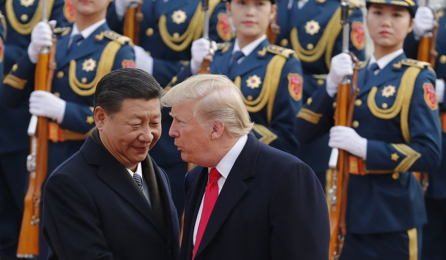 In this Nov. 9, 2017, file photo, U.S. President Donald Trump, right, chats with Chinese President Xi Jinping during a welcome ceremony at the Great Hall of the People in Beijing. (AP Photo/Andy Wong, File)