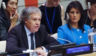 United Nations U.S. Ambassador Nikki Haley, right, listens as Organization of American States Secretary General Luis Almargo speaks during a U.N. meeting on human rights concerns in Venezuela, Monday Nov. 13, 2017, at U.N. headquarters. (AP Photo/Bebeto Matthews)