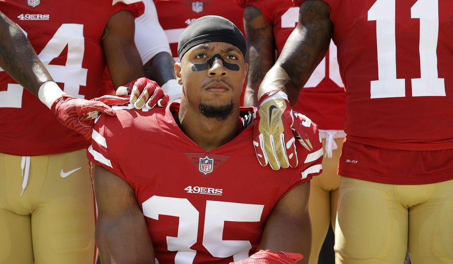 In this Sept. 10, 2017, file photo, San Francisco 49ers safety Eric Reid (35) kneels in front of teammates during the playing of the national anthem before an NFL football game against the Carolina Panthers, in Santa Clara, Calif. Reid says his Christian faith is the reason why he joined former teammate Colin Kaepernick in kneeling for the anthem. (AP Photo/Marcio Jose Sanchez) ** FILE **