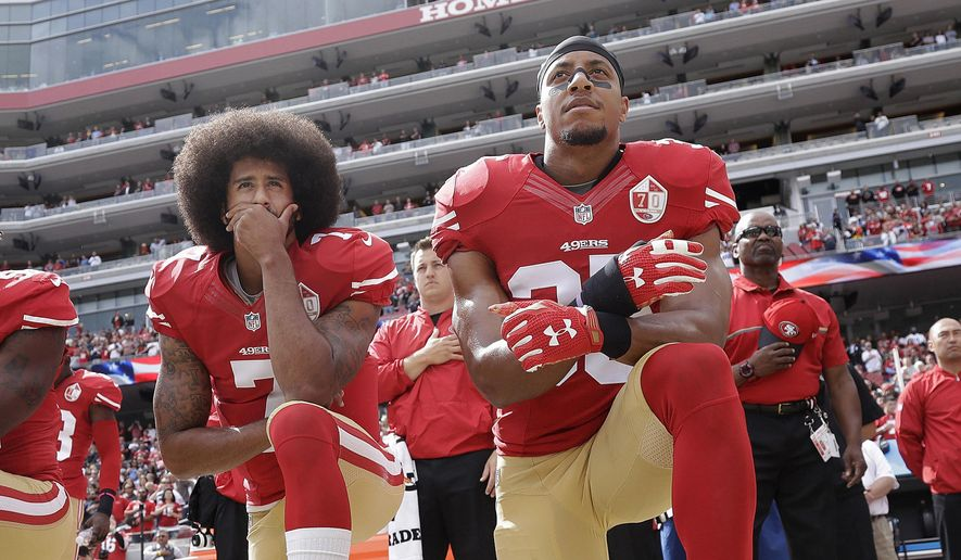 In this Oct. 2, 2016, file photo, San Francisco quarterback Colin Kaepernick, left, and safety Eric Reid kneel during the national anthem before an NFL football game against the Dallas Cowboys in Santa Clara, Calif. Reid says his Christian faith is the reason why he joined former teammate Colin Kaepernick in kneeling for the anthem. (AP Photo/Marcio Jose Sanchez, File) **FILE**