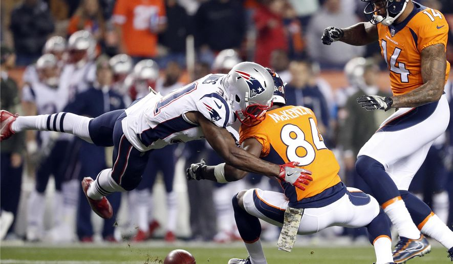 Denver Broncos wide receiver Isaiah McKenzie (84) fumbles the punt as New England Patriots cornerback Jonathan Jones (31) makes the tackle during the first half of an NFL football game, Sunday, Nov. 12, 2017, in Denver. The Patriots recovered the football. (AP Photo/Jack Dempsey)