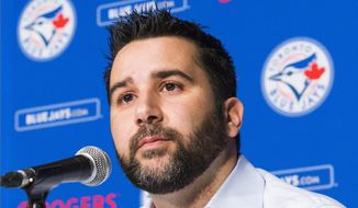 FILE - In this July 28, 2015, file photo, Toronto Blue Jays general manager Alex Anthopoulos speaks at a press conference in Toronto. The Atlanta Braves have selected a young but experienced leader to guide their team, hiring former Dodgers and Blue Jays executive Alex Anthopoulos as their general manager, a person with knowledge of the decision told The Associated Press. Anthopoulos, 40, is expected to be introduced as general manager on Monday, Nov. 13, 2017, the person told the AP, speaking on condition of anonymity Monday because the hiring has yet to be announced. (Mark Blinch/The Canadian Press via AP, File)