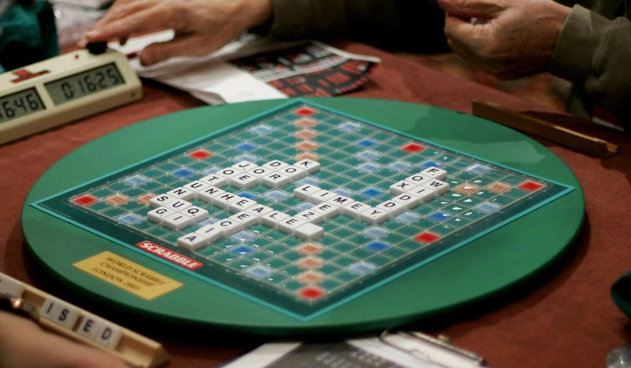 FILE - In this Thursday, Nov. 17, 2005 file photo, competitors take part in the World Scrabble Championships at an hotel in north west London. The Association of British Scrabble players has banned one of its star players, Allan Simmons, for three years after an independent investigation concluded that he had broken the rules of the popular game, it was reported on Monday, Nov. 13, 2017. (AP Photo/Matt Dunham, File)