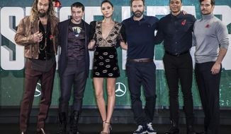 "FILE - This Nov. 3, 2017 file photo shows ""Justice League"" cast members Jason Momoa, from left, Ezra Miller, Gal Gadot, Ben Affleck, Ray Fisher and Henry Cavill at a photo call for the film in London.  The film opens on Friday. (Photo by Vianney Le Caer/Invision/AP, File)"