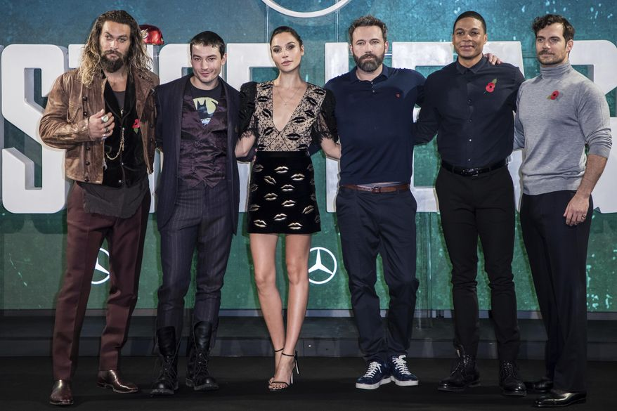 """FILE - This Nov. 3, 2017 file photo shows """"Justice League"""" cast members Jason Momoa, from left, Ezra Miller, Gal Gadot, Ben Affleck, Ray Fisher and Henry Cavill at a photo call for the film in London.  The film opens on Friday. (Photo by Vianney Le Caer/Invision/AP, File)"""