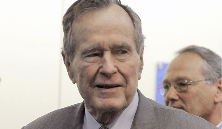In a Tuesday, Dec. 2, 2008 file photo, former President George H. W. Bush leaves a news conference at the Houston hospital. (AP Photo/Pat Sullivan, File)